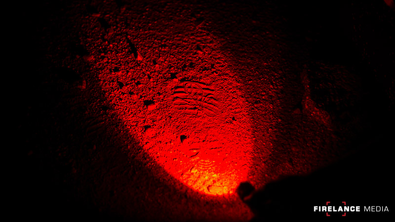 Red light on a footprint during night tracking